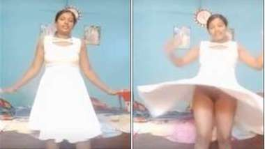 Sexy Desi accidentally flashes her XXX slit dancing in a white dress